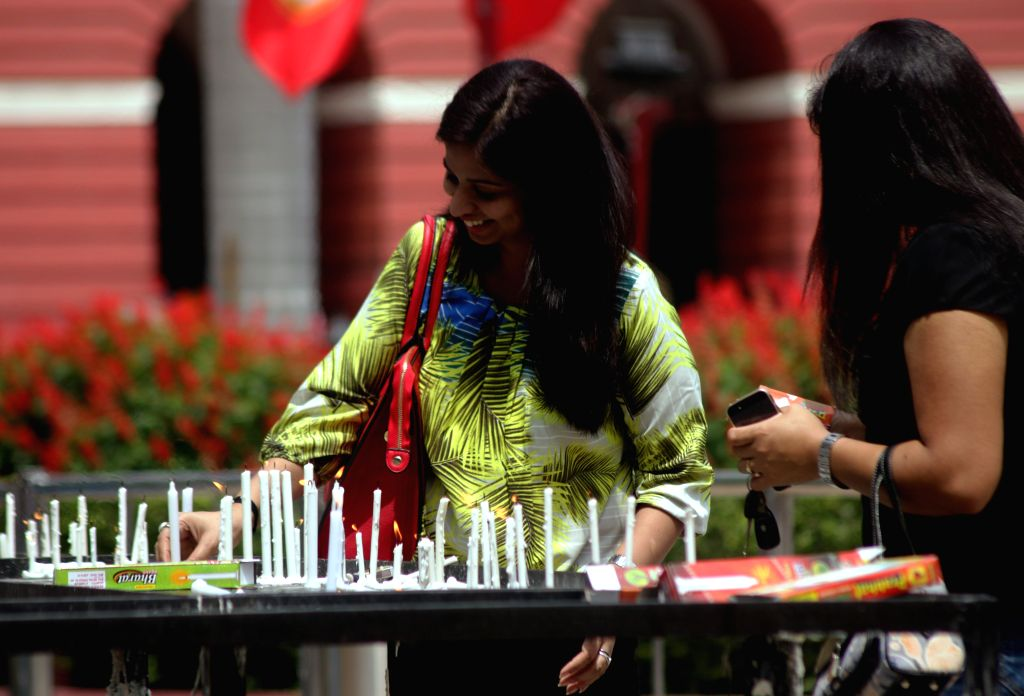 People light candles at a Delhi Church on Good Friday on April 3, 2015.