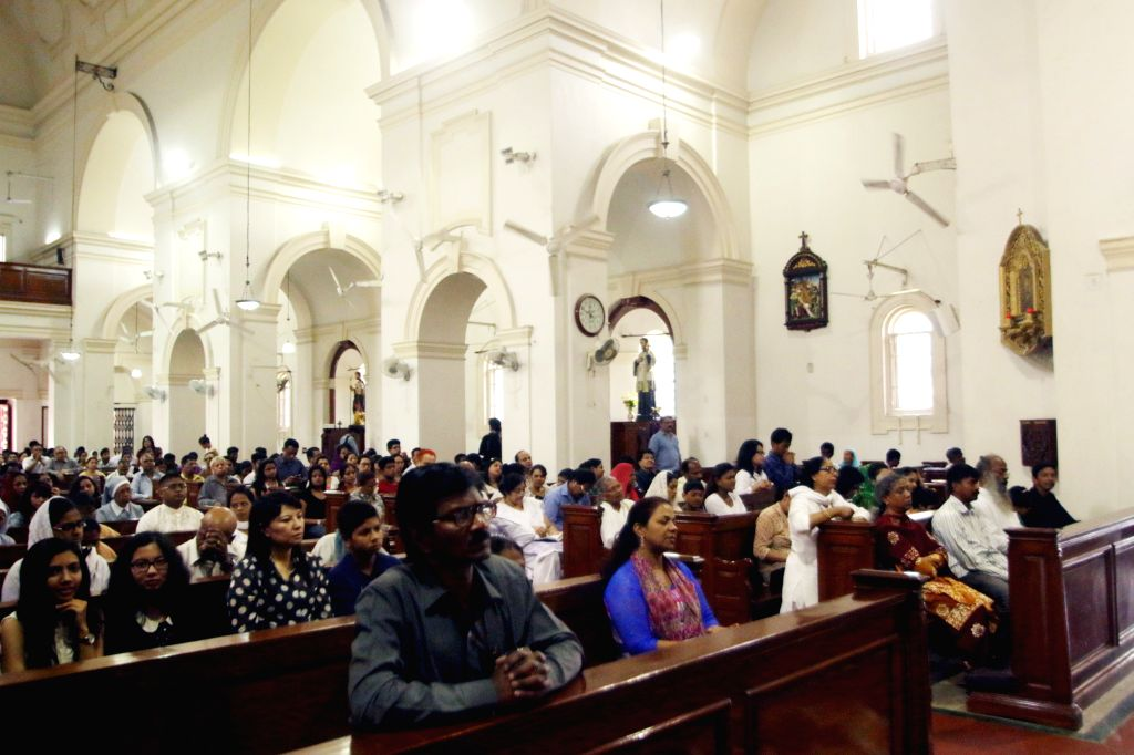 People offer prayers at a Delhi Church on Good Friday on April 3, 2015.