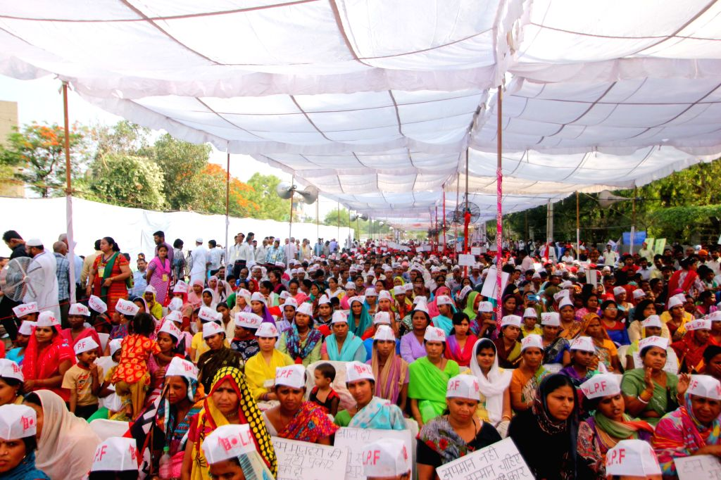 People participate in a May Day programme organised at Shalimar Bagh of Delhi on May 1, 2015.