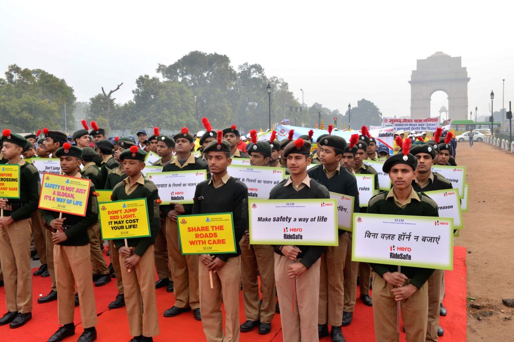 People participate in a rally organised on Road Safety Week at India Gate in New Delhi, on Jan 11, 2015.