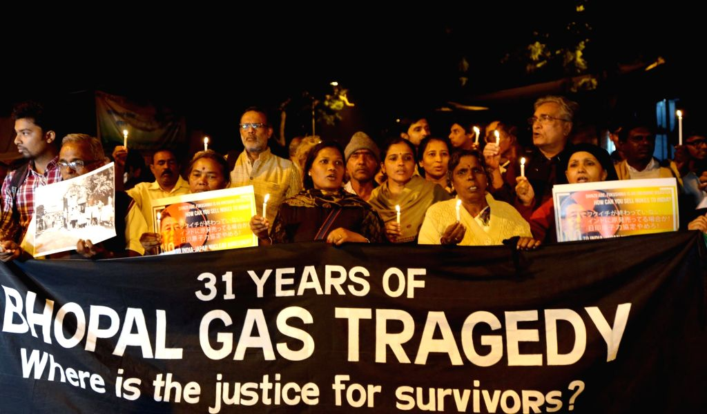 New Delhi: People participate in a rally to observe 31st anniversary of the Bhopal gas tragedy in New Delhi, on Dec 3, 2015. (Photo: IANS)
