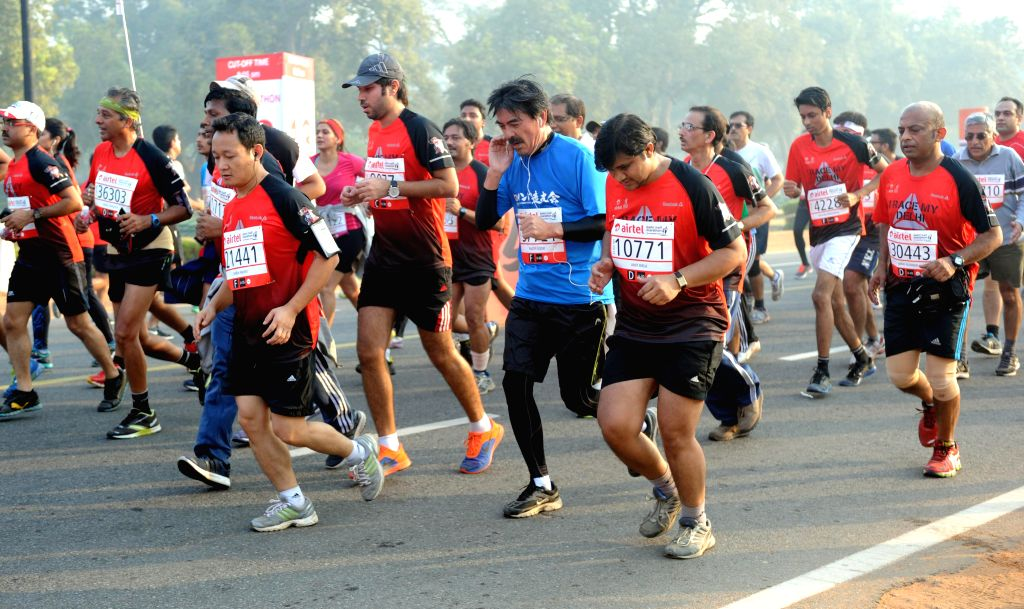 People participate in Airtel Delhi Half Marathon at Jawaharlal Nehru Stadium in New Delhi on Nov 23, 2014.