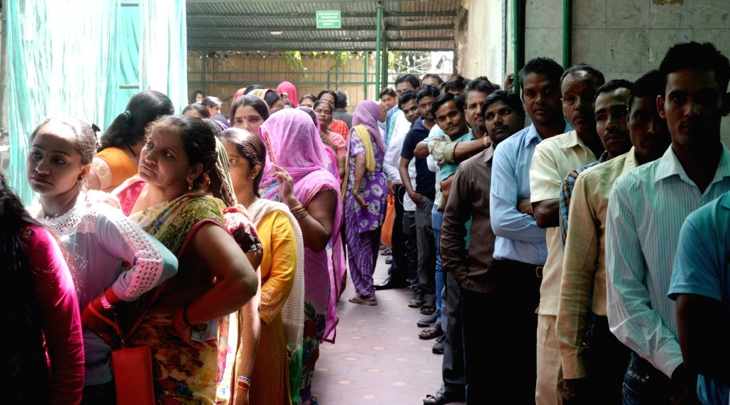 New Delhi: People queue-up at a polling booth to cast their votes during MCD polls in New Delhi on April 23, 2017. Voting for municipal elections across 272 wards of the city started at 8:00 a.m. (Photo: IANS)