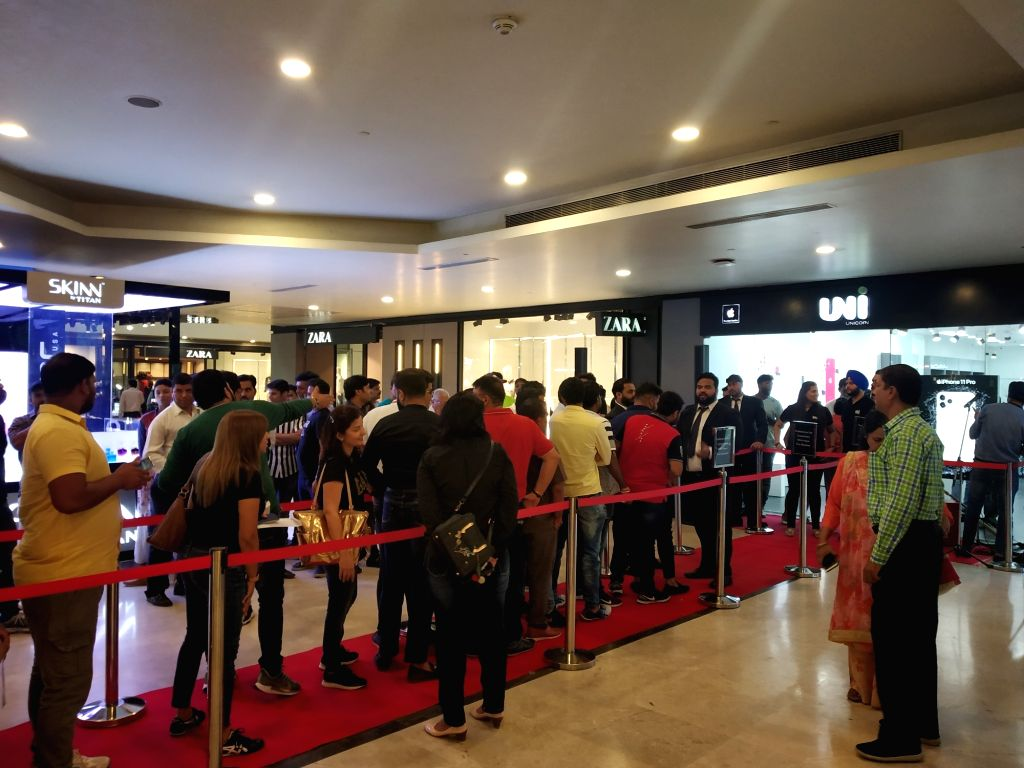 New Delhi: People queue up outside iWorld to purchase iPhones after the iPhone 11, iPhone 11 Pro, and iPhone 11 Pro Max smartphones went on sale across both online and offline retail stores in India; at Pacific Mall in New Delhi on Sep 27, 2019. (Pho