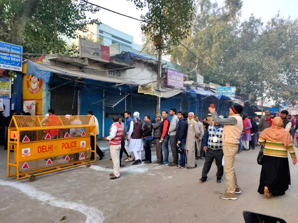 New Delhi: People queue up to cast their votes for the Delhi Assembly elections 2020, at a polling station at Delhi's Shahdara on Feb 8, 2020. (Photo: IANS)