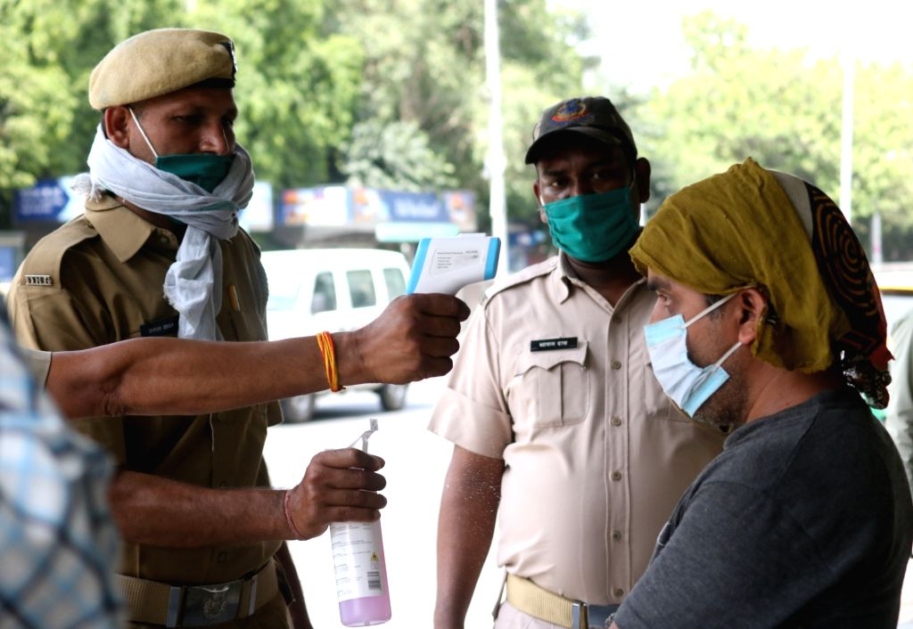 New Delhi: People undergo themal screening for COVID-19 in New Delhi during the fourth phase of the nationwide lockdown imposed to mitigate the spread of coronavirus, on May 23, 2020. (Photo: IANS)