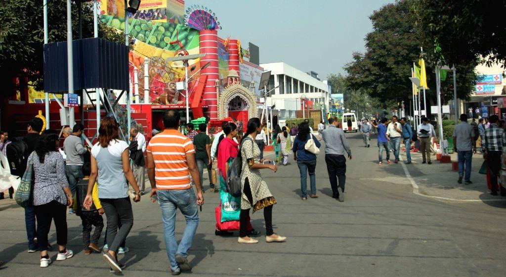 :New Delhi: People visit the 35th India International Trade Fair (IITF) 2015, Pragati Maidan in New Delhi, on Nov 14, 2015. . - Pranab Mukherjee
