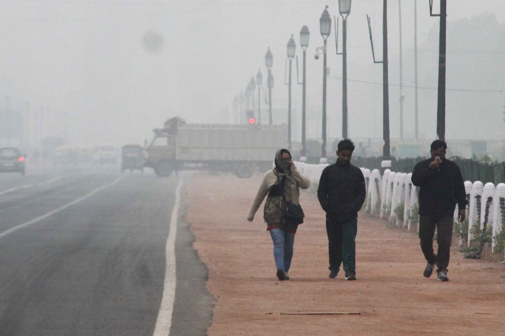 New Delhi: People wear layers of cloths on a cold winter morning in New Delhi, on  Feb 2, 2019. (Photo: IANS)