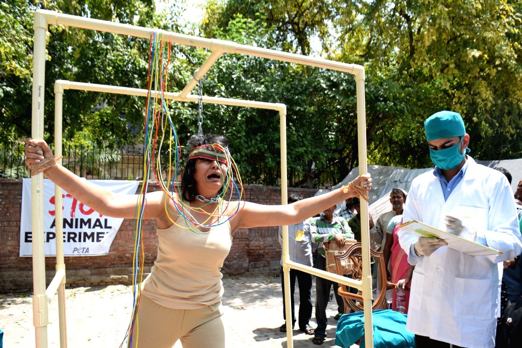 PETA activists participating at a street-theatre-style graphic demonstration to show how animals are abused and killed in laboratories in India and around the world during World Week for ...
