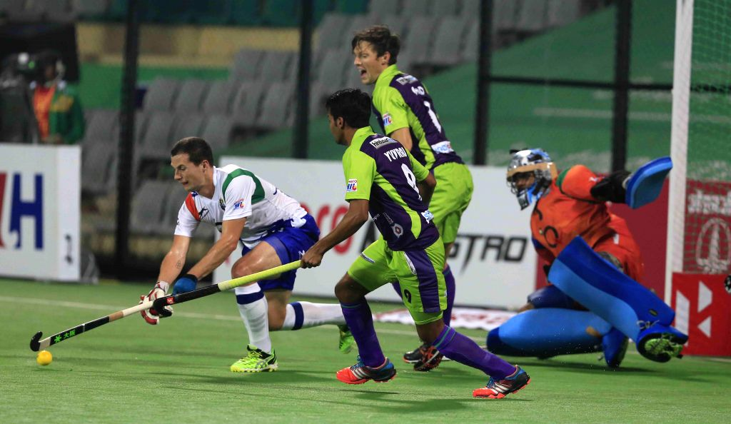 Players in action during a Hockey India League match between Delhi Waveriders and Uttar Pradesh Wizards in New Delhi, on Feb 18, 2015. (Photo : IANS)