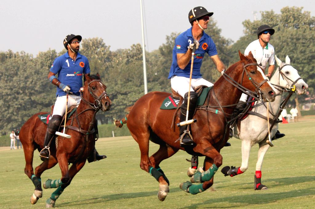 Players in action during the final match of Indian Open Polo Championship 2014 between Sahara Warrior and Jindal Panther in New Delhi, on Nov 16, 2014.