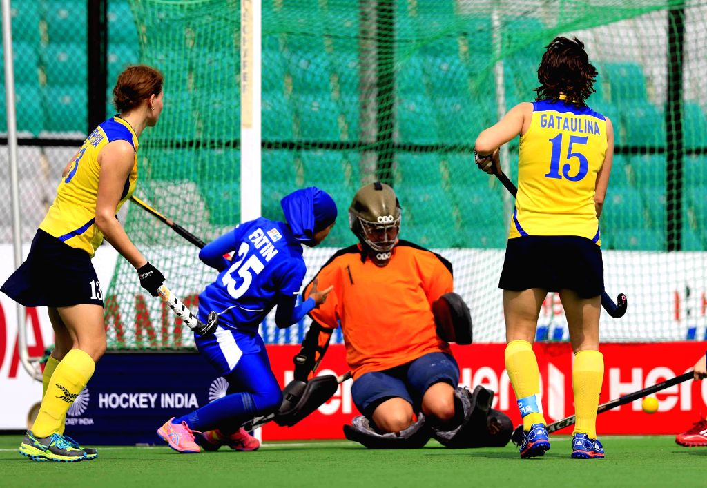 Players of the Malaysian and the Kazakhstan hockey team in action during the inaugural match of  FIH Hockey World League Round 2 (Women) at Major Dhyan Chand National Stadium in New Delhi ...