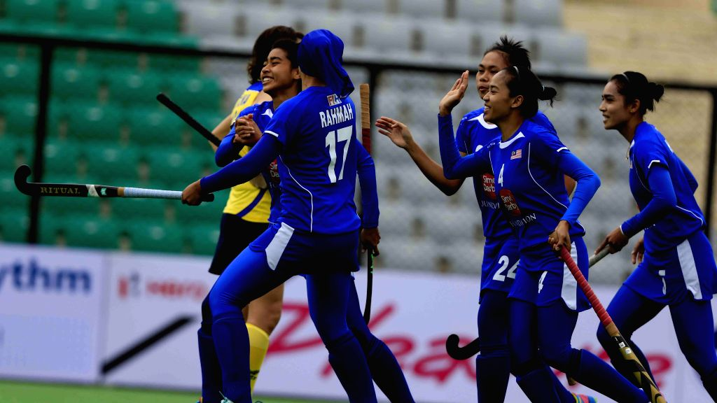 Players of the Malaysian Women Hockey team celebrate a goal during the inaugural match of  FIH Hockey World League Round 2 (Women) at Major Dhyan Chand National Stadium in New Delhi on ...