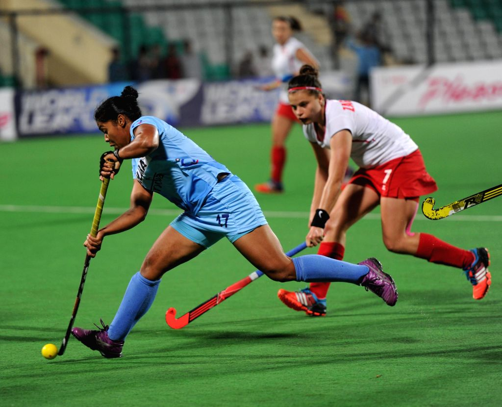 Players of the women team of India and Poland in action during the final match of FIH Hockey World League Round 2 (Women) at Major Dhyan Chand National Stadium in New Delhi on March 15, ...