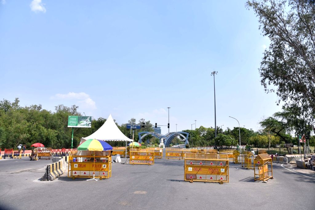 New Delhi: Police barricades put up across the Delhi-Noida border during the extended nationwide lockdown imposed to mitigate the spread of coronavirus; on Apr 24, 2020. (Photo: IANS)