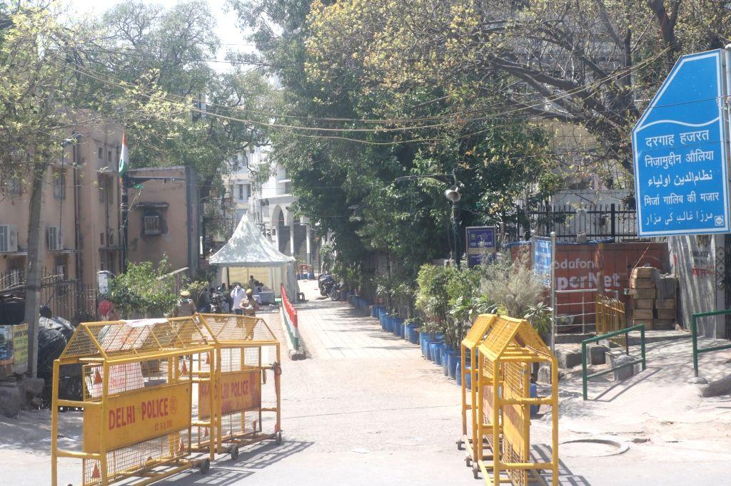 New Delhi: Police barricades seen outside the Nizamuddin Dargah - the shrine of famous sufi saint Nizamuddin Auliya after 24 people tested coronavirus positive at the markaz Nizamuddin in Delhi, on March 31, 2020. (Photo: IANS)
