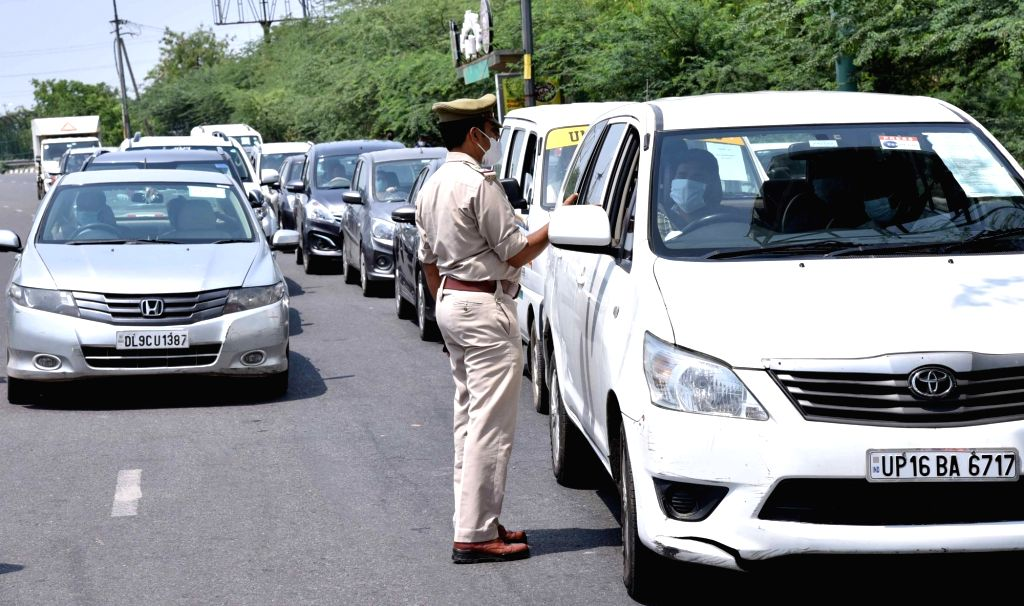 New Delhi: Police conducts checks on vehicles at the Delhi-Noida Border during the extended nationwide lockdown imposed to mitigate the spread of coronavirus; on Apr 21, 2020. (Photo: IANS)