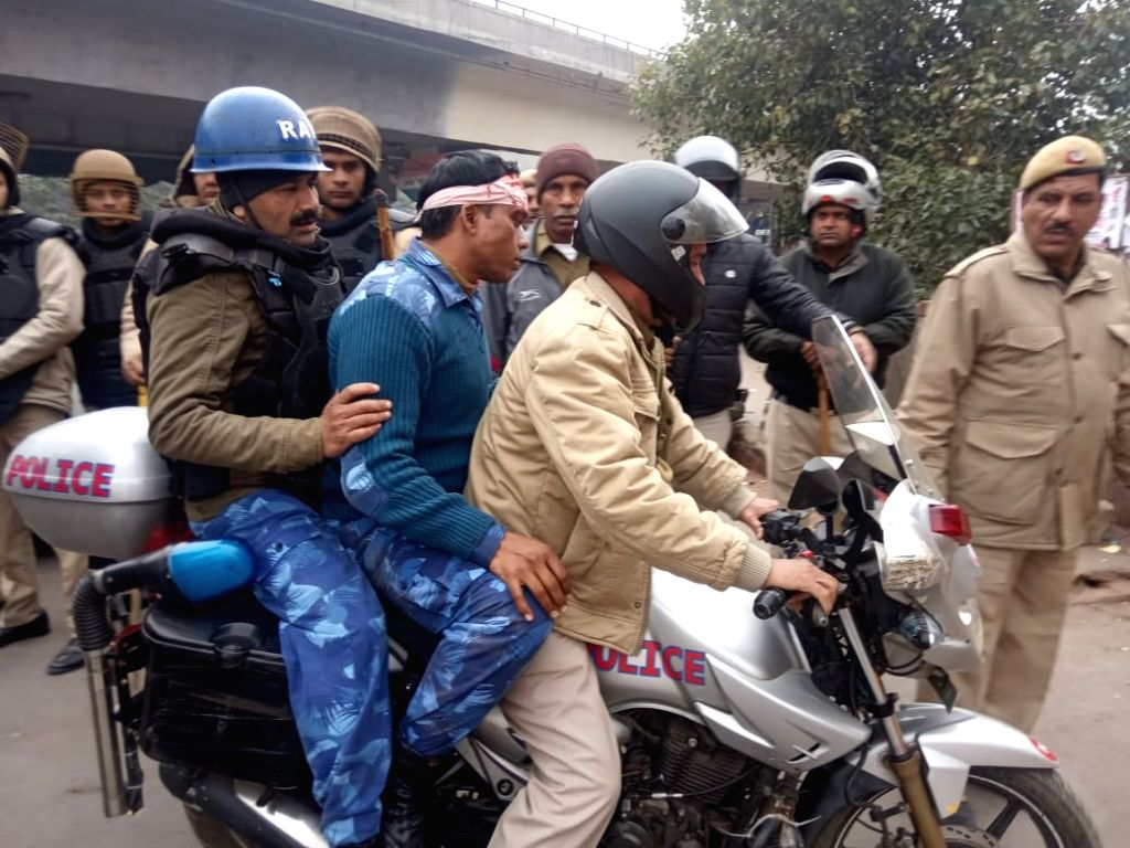 New Delhi: Police personnel at the site in North East Delhi's Seelmapur where a protest against the Citizenship Amendment Act (CAA) 2019 turned violent after protesters pelted stones at police personnel, on Dec 17, 2019. As per reports, many buses of