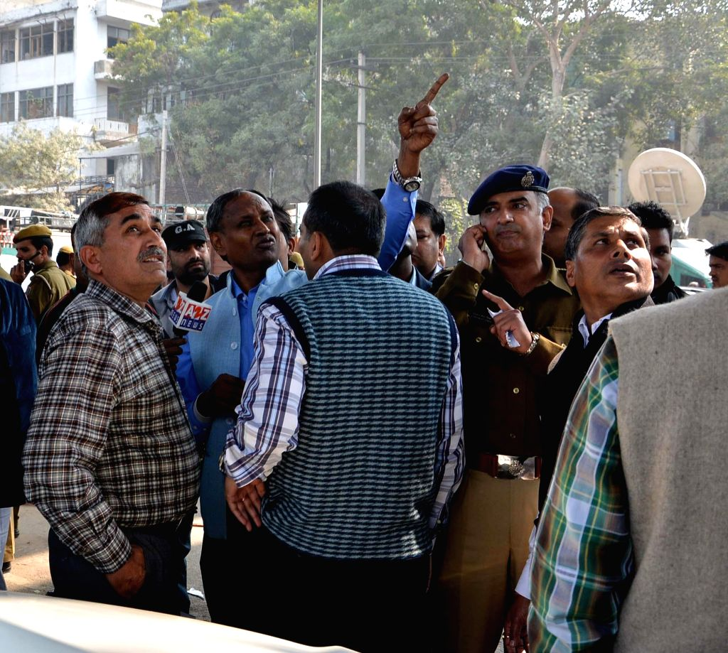 Police personnel at the spot where an under-construction flyover collapsed in New Delhi's northwestern area of Pitampura on Feb 12, 2015.  At least three people were injured in the ...