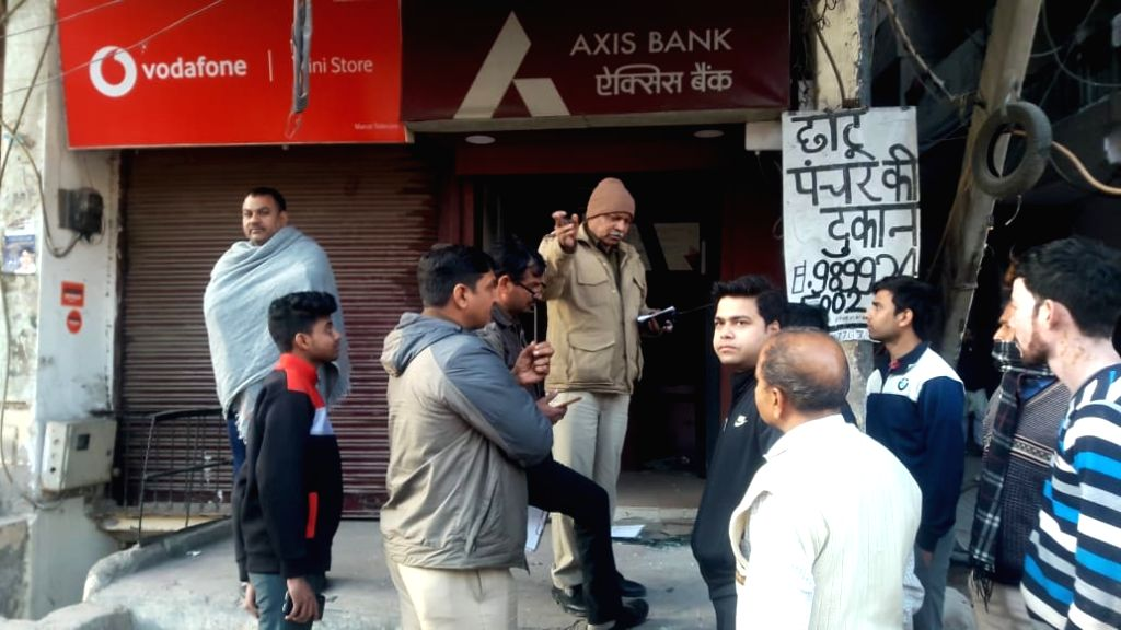 New Delhi: Police personnel investigate the crime scene where robbers took away an ATM machine from Tughlakabad Extension, in New Delhi on Feb 15, 2020. (Photo: Sanjeev Kumar Singh Chauhan/IANS)