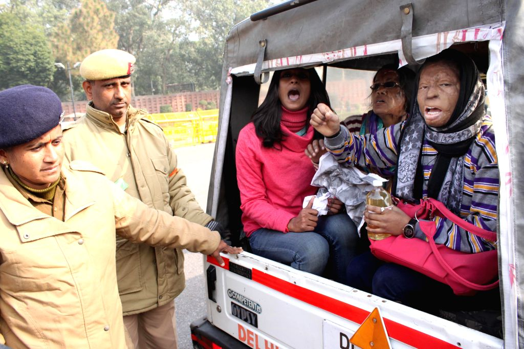 Police takes away the acid attack survivors demonstration  outside the Parliament, in New Delhi, on Dec 18, 2014.