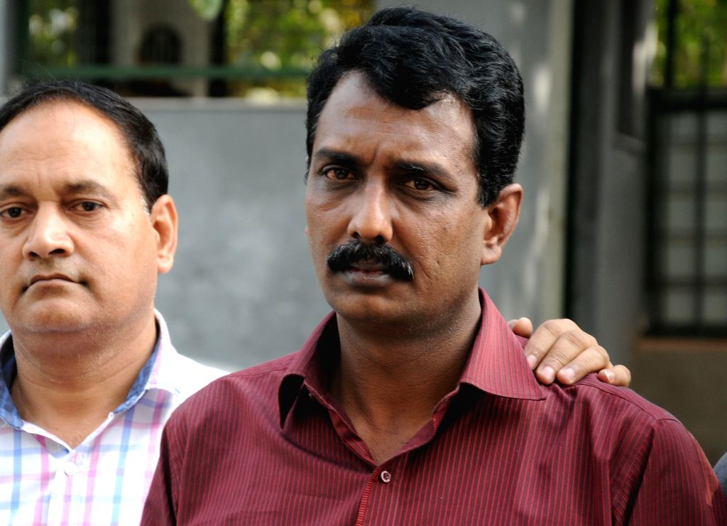Policemen present before press, Satheesh Nair, a 44-year-old PhD degree holder and former college professor who was arrested from west Delhi's Karol Bagh for cheating people by ...