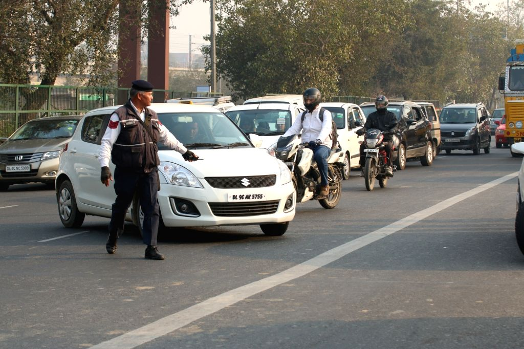 New Delhi: Policemen stop cars with odd registration numbers on the Day-2 of implementation of the state government's odd even formula in the national capital on Jan 2, 2016.  (Photo: Sunil Majumdar/IANS)