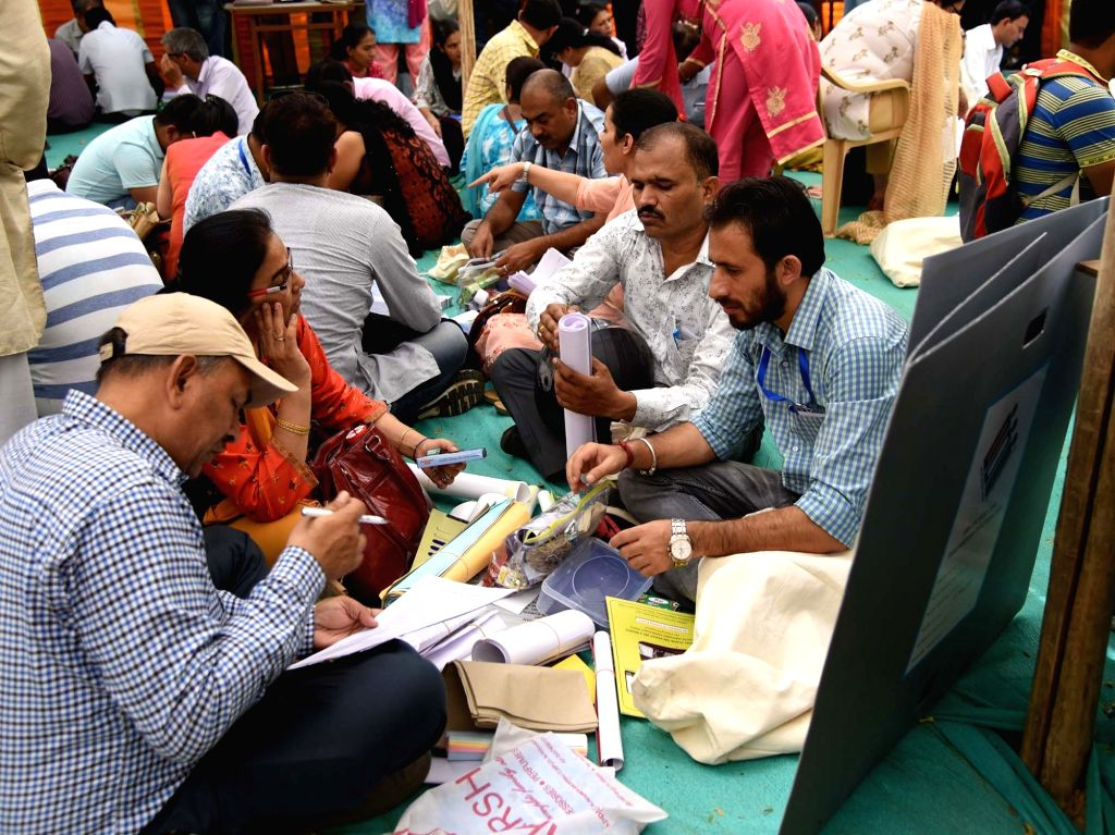 New Delhi: Polling officials check necessary inputs required for the 2019 Lok Sabha elections, at a distribution centre before leaving for their respective polling stations, in New Delhi on May 11, 2019. (Photo: IANS/PIB)