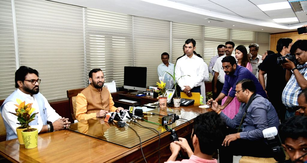 New Delhi : Prakash Javadekar takes charge as the Union Minister for Environment, Forest and Climate Change, in New Delhi on June 01, 2019. Also seen Minister of State for Environment, Forest and ...
