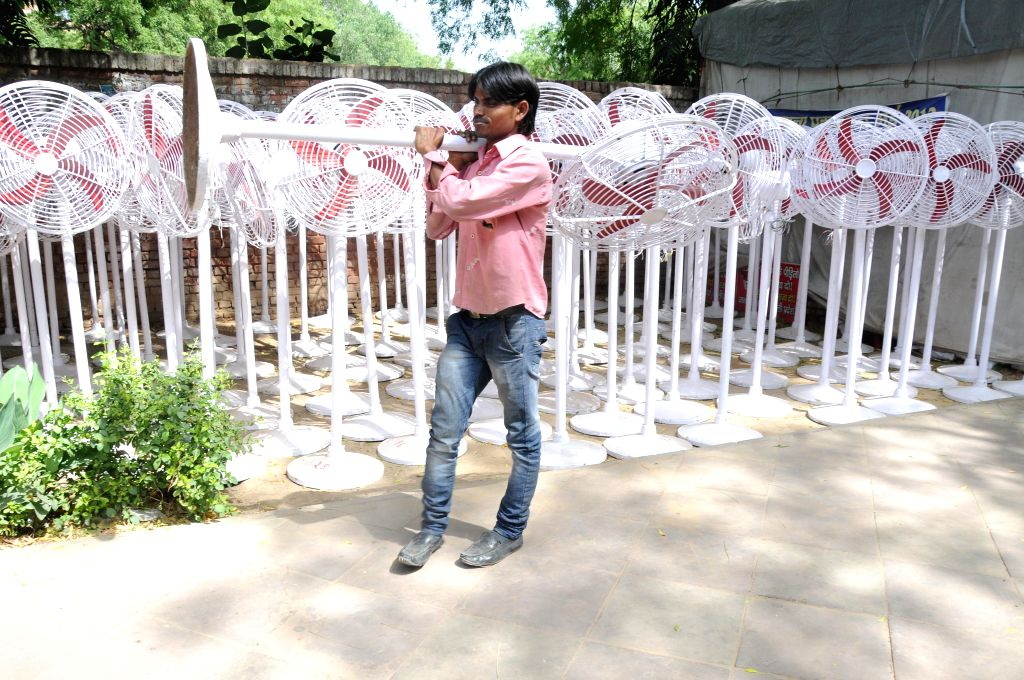 Preparation for Aam Aadmi Party's (AAP) rally against land acquisition ordinance underway at Janatar Manatar in New Delhi, on April 21, 2015.