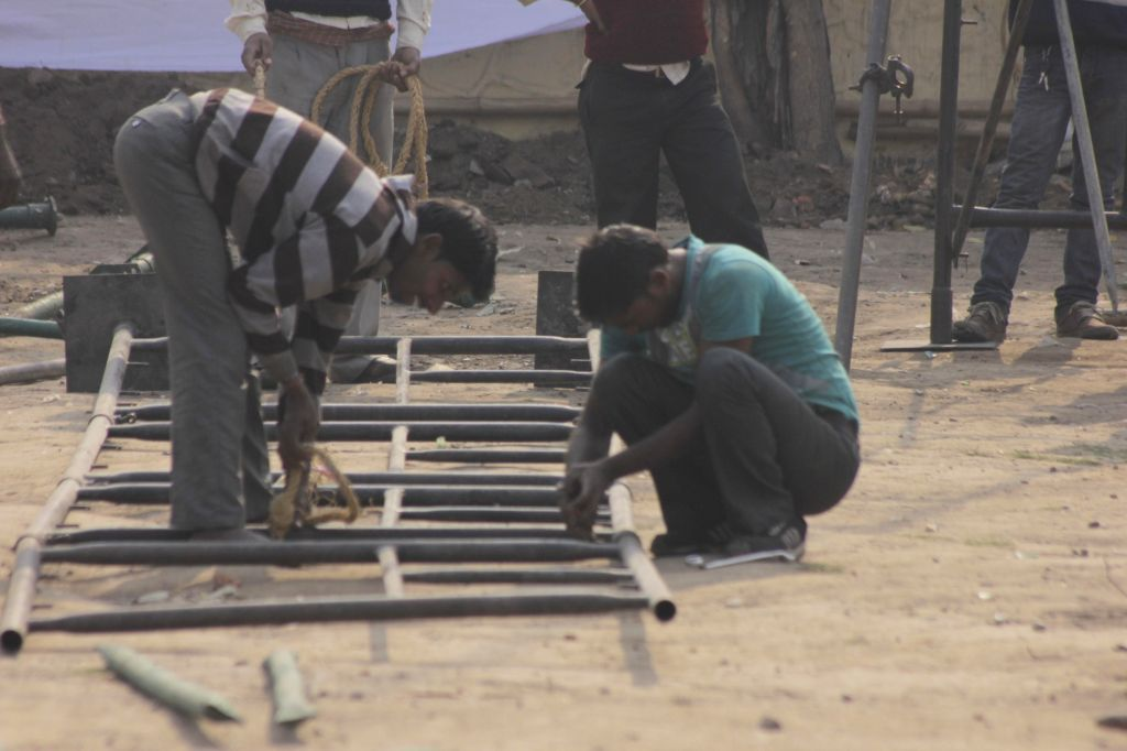 Preparations for Delhi Chief Minister-designate Arvind Kejriwal's swearing-in ceremony underway at Ramlila Maidan in New Delhi, on Feb 12, 2015. - Arvind Kejriwal