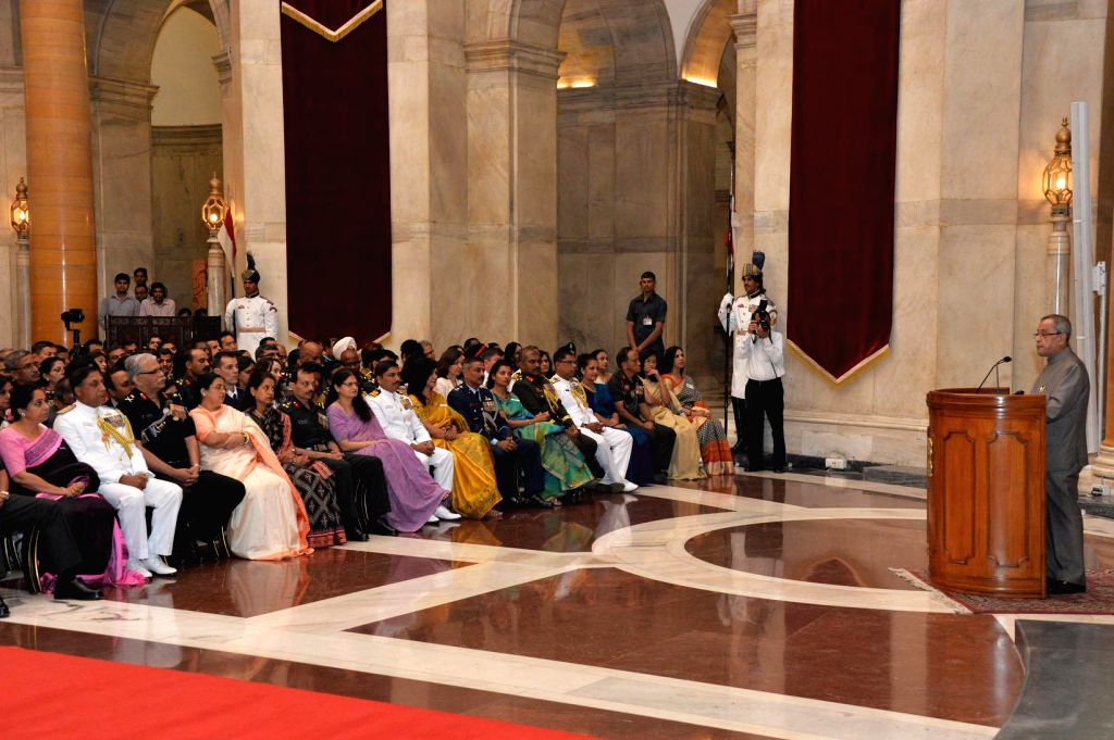 President Pranab Mukherjee addresses the members of 54th NDC Course & Faculty of National Defence College and their spouses at Rashtrapati Bhawan in New Delhi, on Nov 12, 2014. - Pranab Mukherjee
