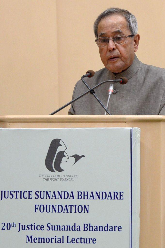 President Pranab Mukherjee addresses during the 20th Justice Sunanda Bhandare Memorial Lecture at Vigyan Bhavan in New Delhi, on Nov 12, 2014. - Pranab Mukherjee