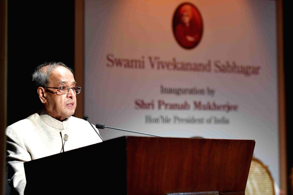 New Delhi: President Pranab Mukherjee addresses during the inauguration of the Swami Vivekananda Sabhagar at Kathak Kendra of Sangeet Natak Akademi, in Kathak Kendra, Chanakyapuri, New ... - Pranab Mukherjee