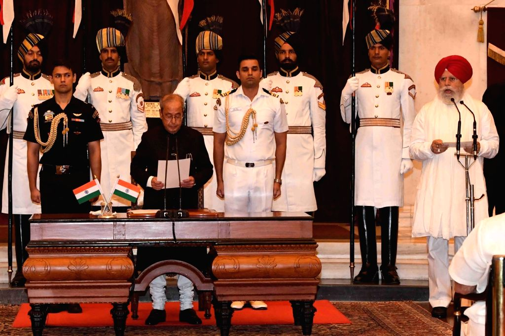 New Delhi: President Pranab Mukherjee administers the oath of Minister of State to S.S. Ahluwalia, at a swearing-in ceremony organised at Rashtrapati Bhavan, in New Delhi on July 5, 2016. - Pranab Mukherjee