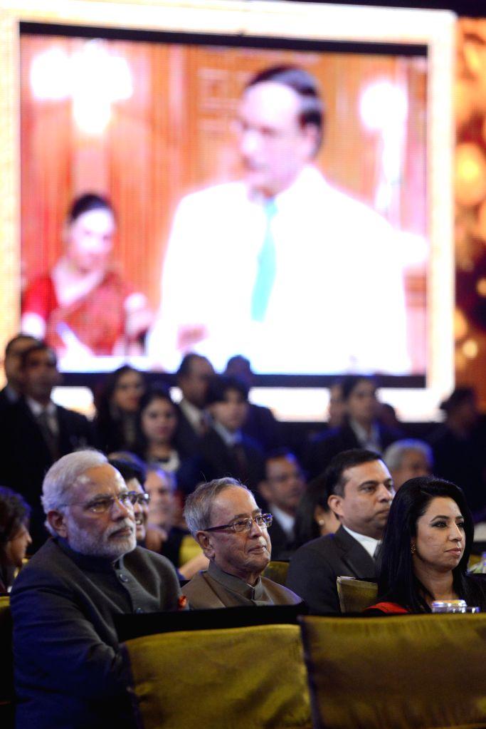 President Pranab Mukherjee and Prime Minister Narendra Modi during a programme organised to celebrate 21 years of `Aap Ki Adalat` a TV show at Pragati Maidan in New Delhi on Dec 2, 2014. - Narendra Modi and Pranab Mukherjee