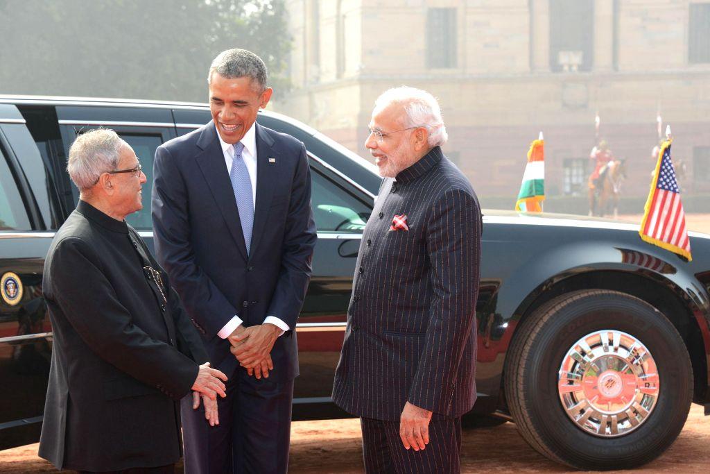 President Pranab Mukherjee and Prime Minister Narendra Modi welcome US President Barack Obama at the Rashtrapati Bhavan  in New Delhi, on Jan 25, 2015. - Narendra Modi and Pranab Mukherjee
