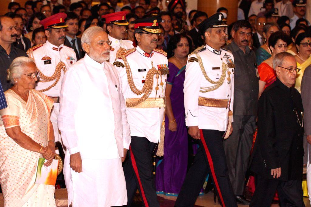 President Pranab Mukherjee and Prime Minister Narendra Modi during the Defence Investiture Presentation Ceremony  at Rashtrapati Bhavan in New Delhi, on March 21, 2015. - Narendra Modi and Pranab Mukherjee