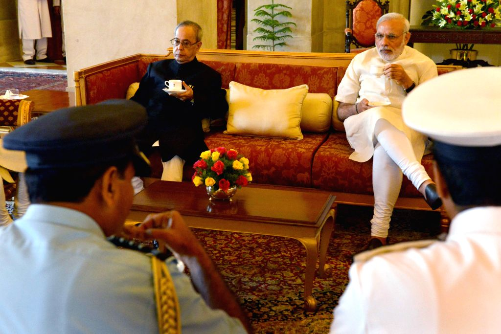 President Pranab Mukherjee and Prime Minister Narendra Modi at the Defence Investiture Ceremony–II, at Rashtrapati Bhavan, in New Delhion April 26, 2015. - Narendra Modi and Pranab Mukherjee