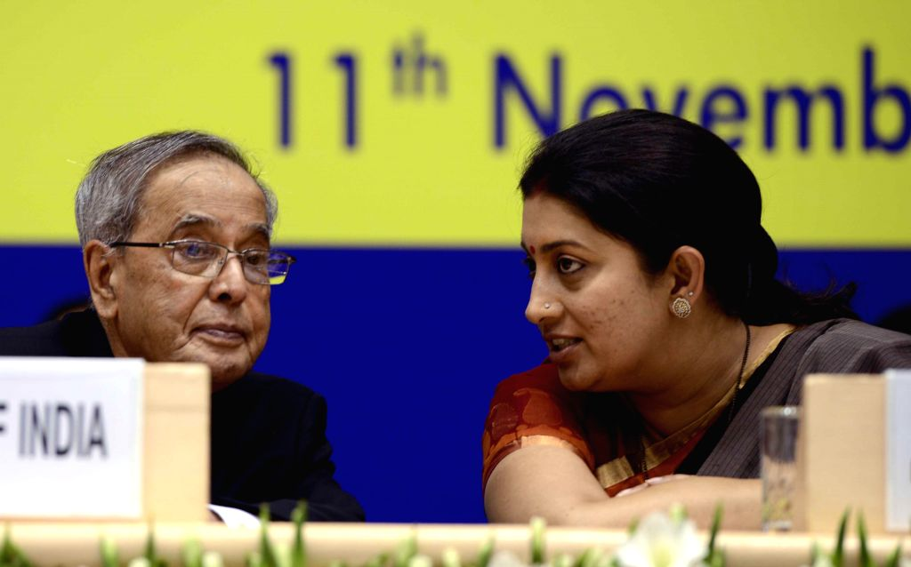 President Pranab Mukherjee and Union HRD Minister Smriti Irani during a programme organised on National Education Day in New Delhi, on Nov 11, 2014. - Smriti Irani and Pranab Mukherjee