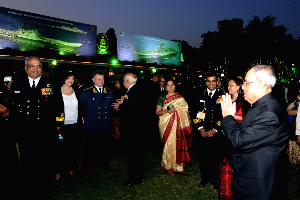 President Pranab Mukherjee arrives to attend Navy Day reception hosted by the Chief of Naval Staff R.K. Dhowan at Navy House in New Delhi, on Dec 4, 2014. - Pranab Mukherjee