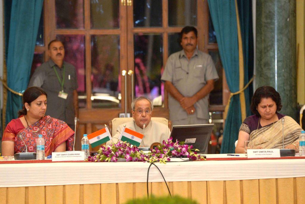 :New Delhi: President Pranab Mukherjee at the Visitor`s Conference 2015 at Rashtrapati Bhavan, in New Delhi on Nov. 5, 2015. Also seen Union Minister for Human Resource Development Smriti Irani. ... - Pranab Mukherjee