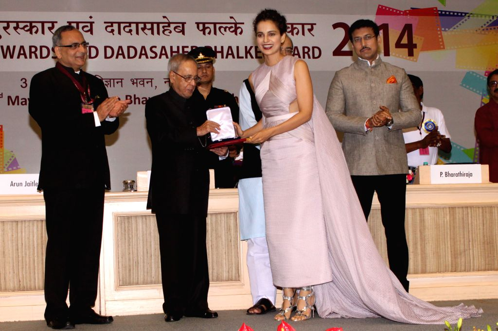 President Pranab Mukherjee awards best actress award to actress Kangna Ranaut at the 62nd National Film Awards ceremony organised at Vigyan Bhavan in New Delhi, on May 3, 2015. Also seen ... - Kangna Ranaut, Pranab Mukherjee, Arun Jaitley and Rajyavardhan Singh Rathore