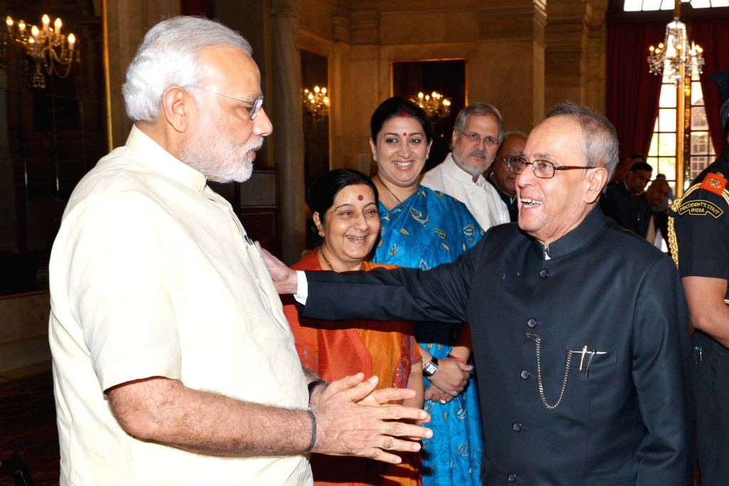 President Pranab Mukherjee being greeted by Prime Minister Narendra Modi during a ceremony organised ahead of his departure for Russia, at the Rashtrapati Bhavan in New Delhi on May 7, ... - Narendra Modi, Sushma Swaraj, Pranab Mukherjee and Smriti Irani
