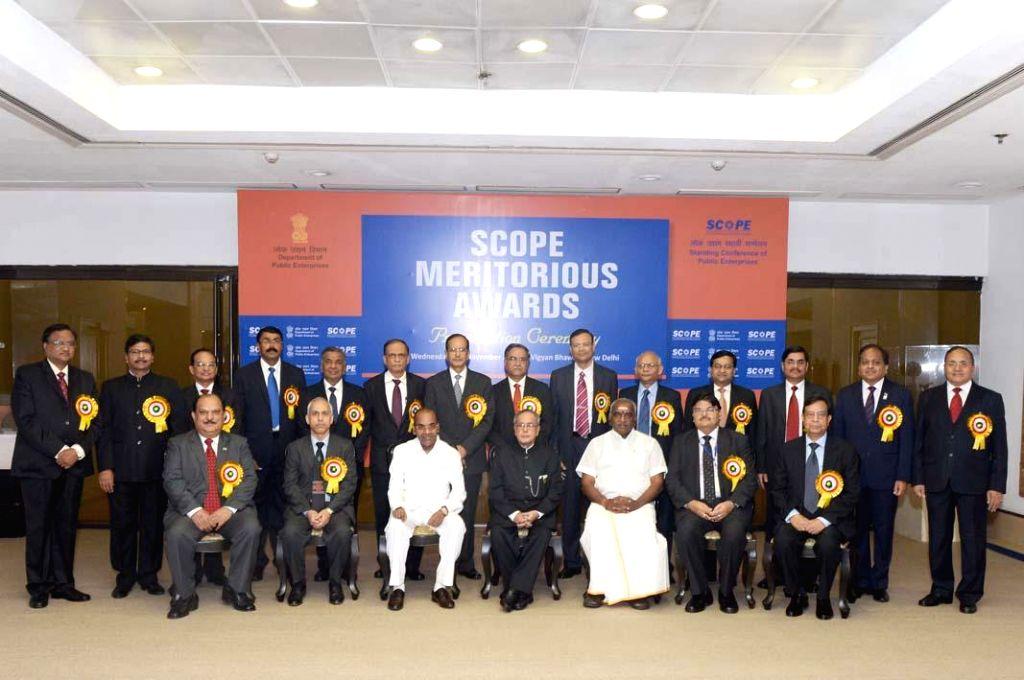 President Pranab Mukherjee during the presentation of the Standing Conference of Public Enterprises (SCOPE) Meritorious Awards at Vigyan Bhavan in New Delhi on Nov. 5, 2014.