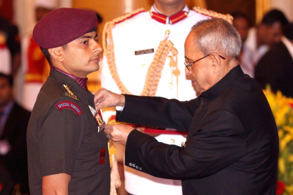 President Pranab Mukherjee presents Kirti Chakra to Captain Jaidevat during the Defence Investiture Presentation Ceremony  at Rashtrapati Bhavan in New Delhi, on March 21, 2015. - Jaidevat and Pranab Mukherjee