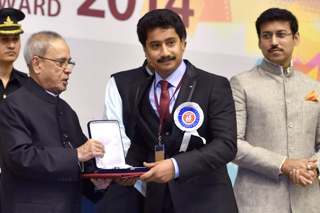 President Pranab Mukherjee presents best actor award to Vijay Kumar B at the 62nd National Film Awards ceremony organised at Vigyan Bhavan in New Delhi, on May 3, 2015. - Pranab Mukherjee and Vijay Kumar B