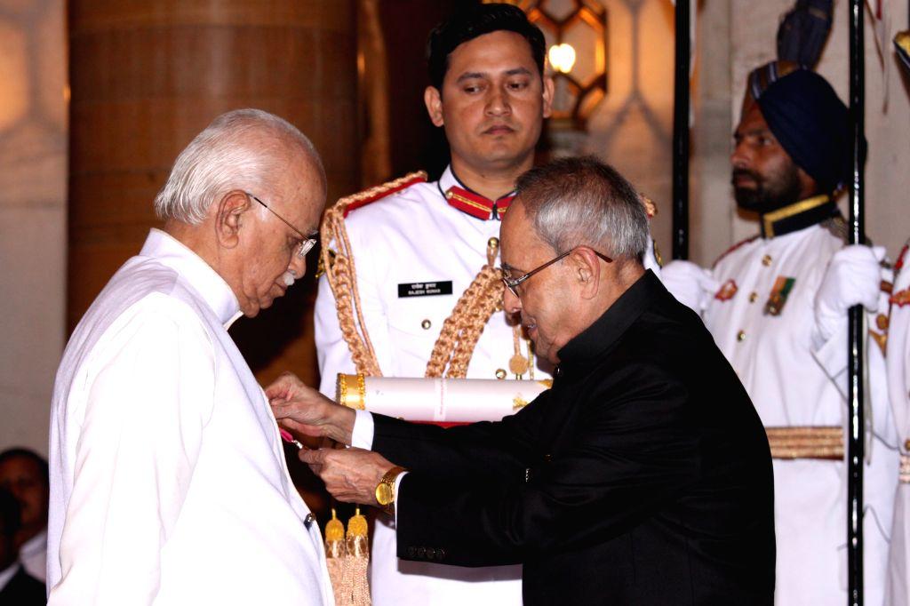 President Pranab Mukherjee presents the Padma Vibhushan Award to veteran politician and parliamentarian L K Advani at a Civil Investiture Ceremony, at Rashtrapati Bhavan, in New Delhi on ... - Pranab Mukherjee and L K Advani
