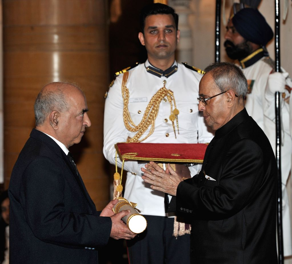 President Pranab Mukherjee presents the Padma Shri Award to Prof. Yog Raj Sharma, at a Civil Investiture Ceremony, at Rashtrapati Bhavan, in New Delhi on April 8, 2015. - Pranab Mukherjee