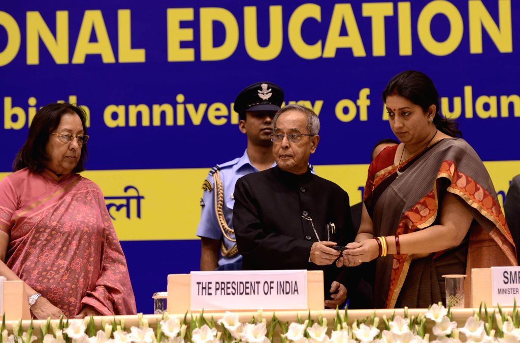 President Pranab Mukherjee, Union HRD Minister Smriti Irani and Minority Affairs Minister Dr. Najma A. Heptulla during a programme organised on National Education Day in New Delhi, on Nov . - Smriti Irani, Najma A. Heptulla and Pranab Mukherjee